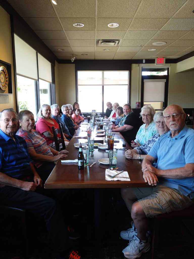 Young at Heart 50 Plus group eating together